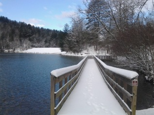 The boardwalk at Black Rock Lake covered in snow.